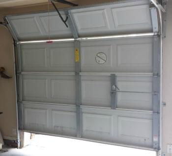 Garage Door won't close because of sagging chain