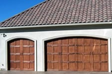 double and single stained wood garage door