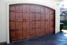 stained wood garage door with hardware