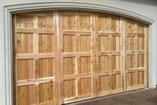 natural wood arched garage door